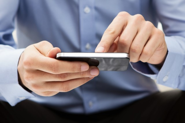 Young adult using a smart phone